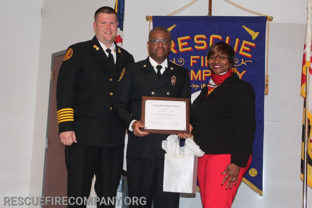 (City 20 Years of Service Certificate) Chie Adam Pritchett, FF Kevin Car, Mayor Victoria Jackson-Stanley