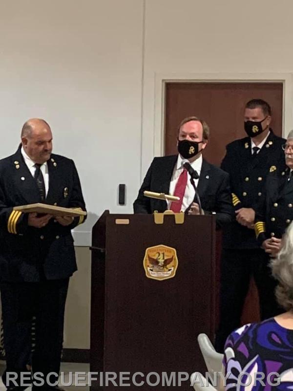 Mayor Andrew Bradshaw presenting A Length of Service Award to RFC Chaplin Gary Hickman (35 years of Service)