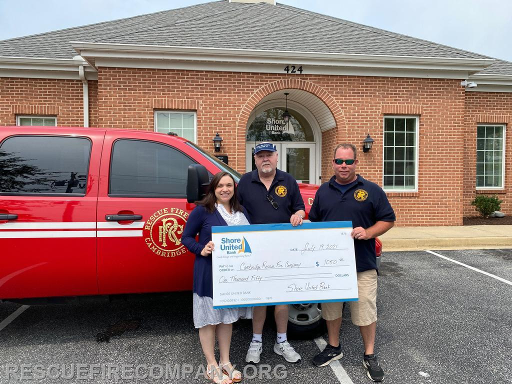 Pictured Christine Hudson (Shore United Bank of Cambridge Branch Manager), Past President Calvin Stack, & Assistant Chief Ben McCarter